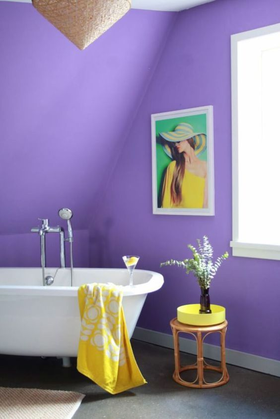 bathroom, purple sloping wall, gey floor, white tub, rattan side table, rattan pendant