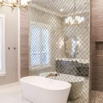 Bathroom, White Marble Floor Tiles, Arabesque Tiles Partition, White Tub, Brown Stone Floor On Shower, Brown Wall, Chandelier