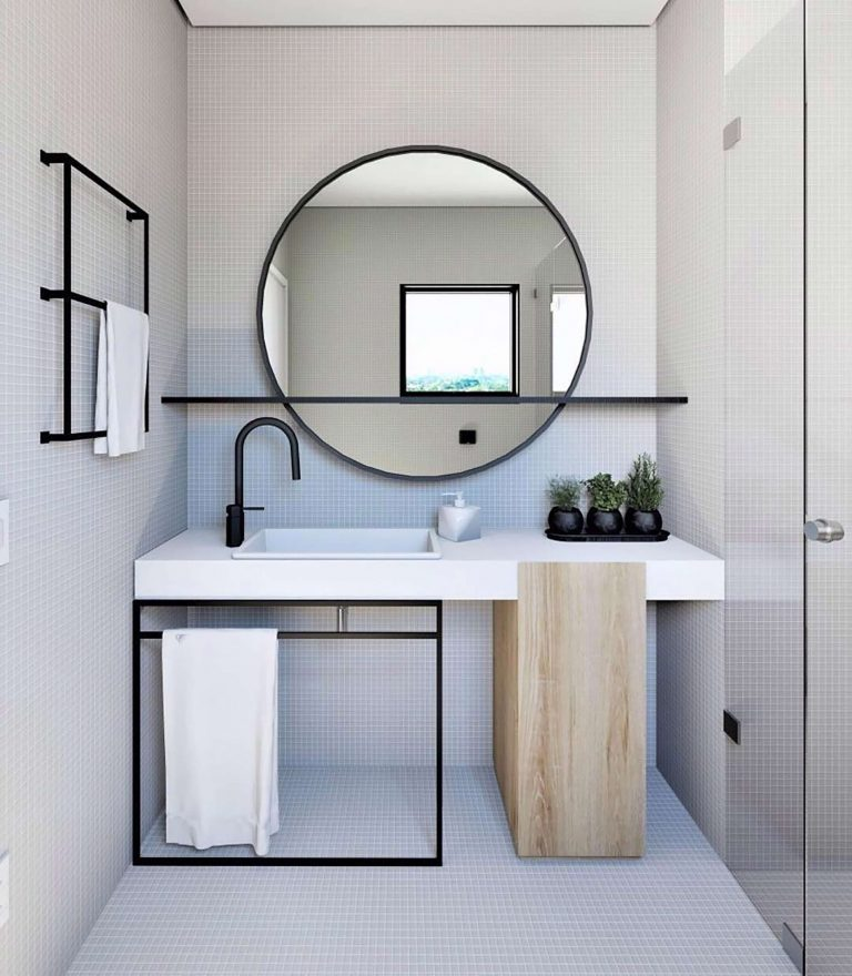 bathroom, white top vanity, wooden posts, black metal support, black metal racks, big round mirror, black floating shelves, black faucet, tiny square wall floor tiles
