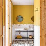 Bathroom, Yellow Wall, Whtie Tiles Wainscoting, Black Metal Vanity Tables, White Top, White Sinks, Hexagonal Tiles