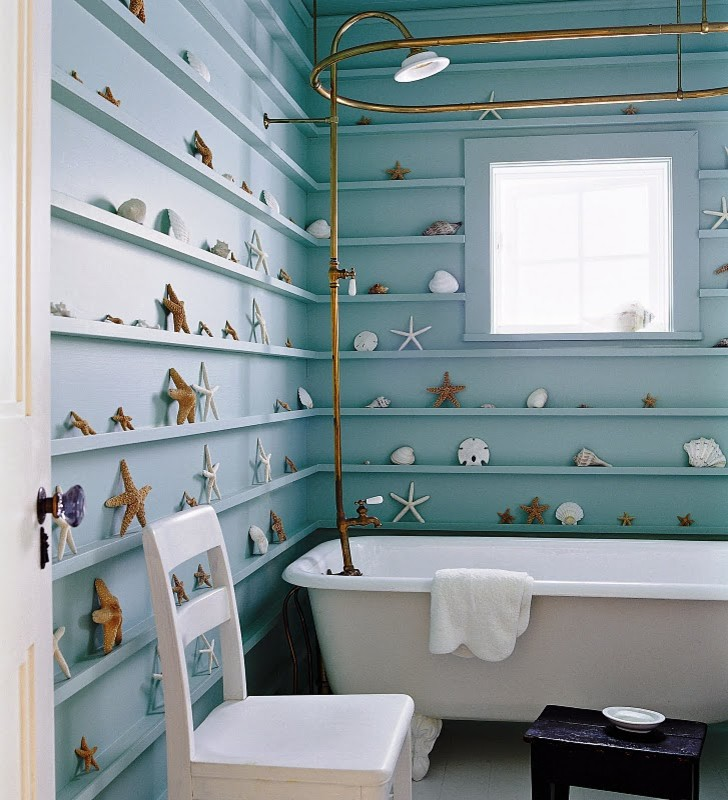 beachy bathroom blue wall blue mini shelves starfish coral square window gold shower curtain rod freestanding bathtub white chair window shade black wooden stool