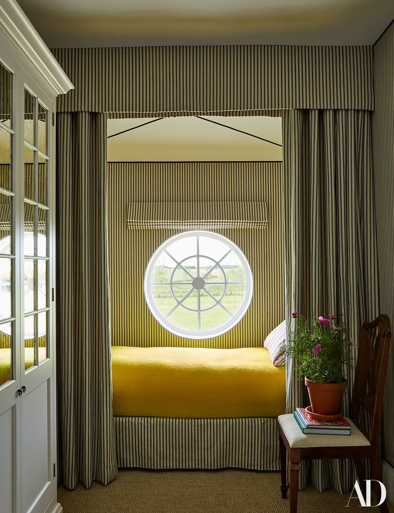 bed nook, striped curtain, wall, bed platform cover, yellow bedding, round glass window