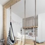 Bedroom, Wooden Chevron Floor, White Wall, Wooden Beam For Swing And Hammock, White Low Table And Chair, Shelves, Rope On Top Of The Shelves