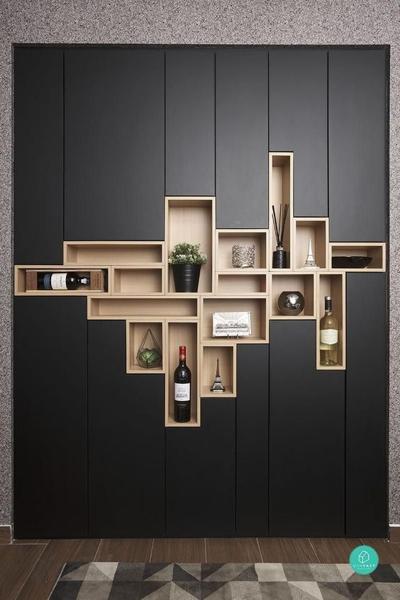 black cabinet with long narrow line details, shelves in different sizes in the middle of the cabinet