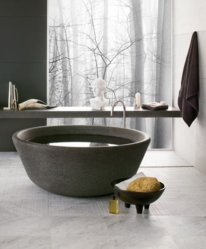 black stone round tub, golden faucet, floating shelves, marble floor tiles