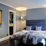 Blue And Gray Bedroom Gray Walls Blue Bedding Artwork Grey Duvet Blue Pillows White Side Tables Chrome Wall Sconces