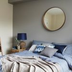 Blue And Gray Bedroom Round Wall Mirror Grey Walls Blue Table Lamps Rattan Side Table Blue Bedding Pillows Grey Throw