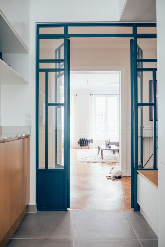 blue framed glass partition with door in the middel, lines frames