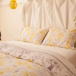 Bohemian Duvet Cover Silk Fabric Wooden Stool Glass Flower Vase White Walls Yellow Pendant Lamp Wooden Side Table Pillows