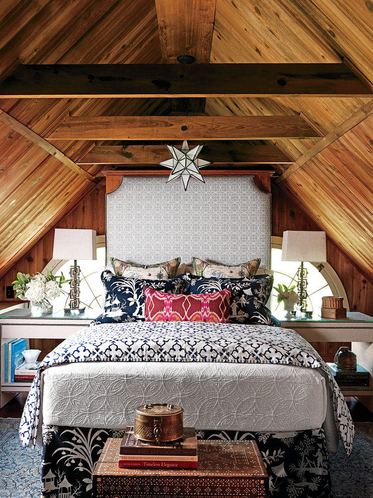 bohemian duvet cover wooden vaulted ceiling chandelier high headboard white glass nightstands trunk white table lamps windows grey rug