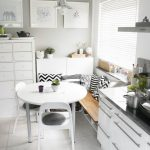 Corner Breakfast Bar, Wooden Bench, Shelves Under, Pilows, White Round Table, White Chair, Grey Wall, Pendant, White Cabinet Grey Marble Top