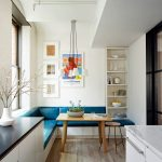 Corner Dining Nook, White Corner Bench, Blue Leather Cushion, White Pendants, White Wall, White Shelves, Square Wooden Table, Wooden Stool