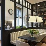 Corner Kitchen, White Cabinet, White Wall, Silver Pendants, Clock, Black Wooden Partition, Striped Cushion Bench, Black Table, Nude Chair, Rectangular Pendant
