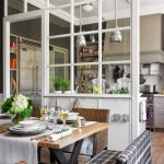 Dining Nook, Wooden Table, Rattan Chairs, Bench With Plaid Cover, Glass Partition, Wooden Floor, Pendant, Ceiling Lamp, Kitchen Wih White Cabinet