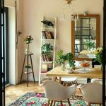 Dining Room, Herringbone Wooden Floor, Colorful Rug, Beige Wall, White Bookcase, Tall Side Table, Wooden Table And White Modern Chairs
