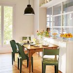 Dining Set With Wooden Table, Green Metal Chair, Black Pendant, Wooden Floor, White Wall, White Parition With Glass