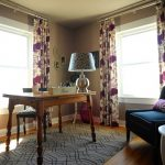 Drapery Pole Floral Drapes Table Lamp Wooden Desk Grey Rug Wooden Chair Dark Blue Low Armchair Windows White Side Table