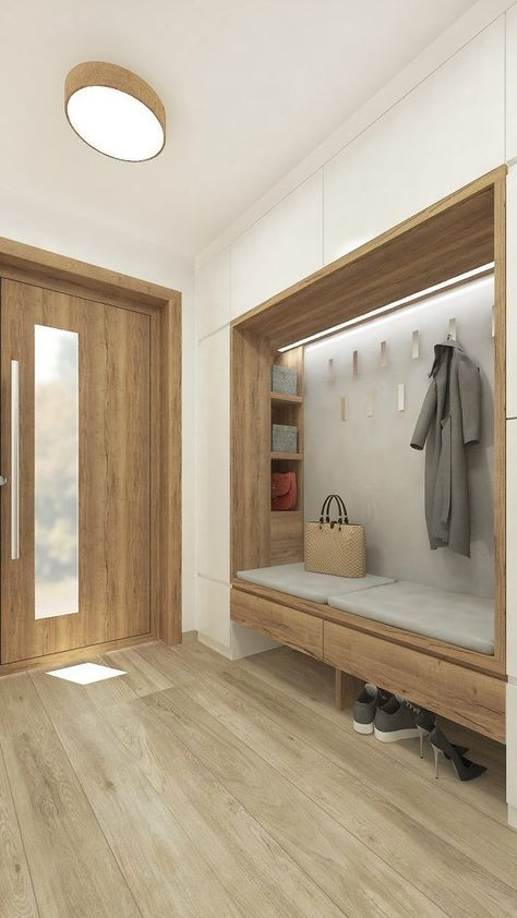 entrance with white smooth cupboard, wooden nook with shelves ont he side wall, hooks, floating wooden bench with grey cushion