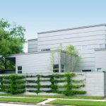 Exterior Landscaping Grey Hard Panels Grass Trees Glass Windows Flat Roofs Sidewalk Grey Home Wall Planting