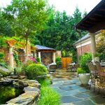 Exterior Landscaping Small Pool Stone Border Rustic Steel Barstools Stone Flooring Brick Wall Concrete Table Top Outdoor Chairs Table Gazebo