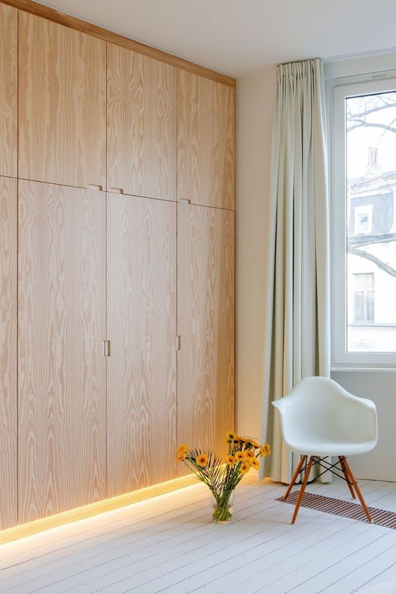 floating cupboard with natural wooden look walltall, white modern chair, white wooden floor, white wall, white curtain