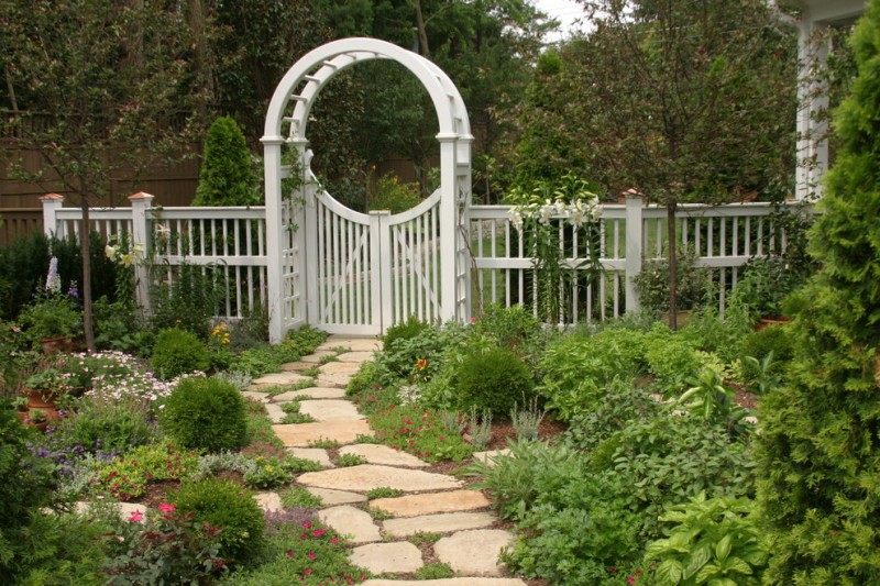 garden arbor ideas stone walk grass flowers mini garden white wooden fence white wooden gate white wooden arbor