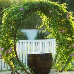 Garden Arbor Ideas White Wooden Low Garden Fence Black Stool Stainless Steel Wire Grass Flowers Rocky Space