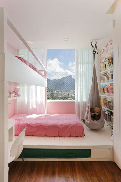 girl teen bedroom, white wooden platform, display shelves, hammock, white table and chair