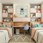 Girl Teens Bedroom, Grey Rug, Two Beds, Shelves On The Headboard, Table In The Middle