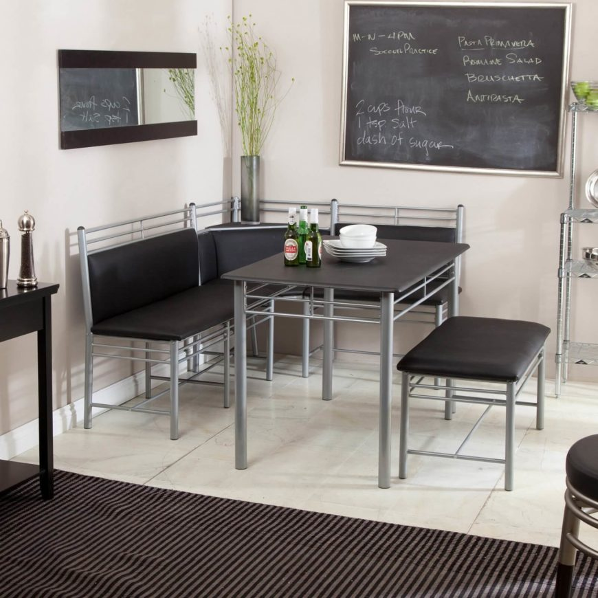 grey metal dining nook, withblack cushion on corner bench and bench, black table top