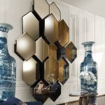 Honeycomb Mirrors In Different Levels Of Height, White Wall, Glossy Flor, Vase