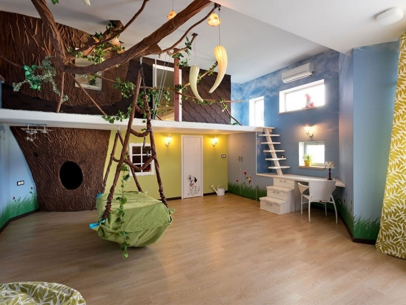 kid bedroom with wooden floor, hang bed, fake tree inside wth brances, white second level, white stairs, white study table, white chair