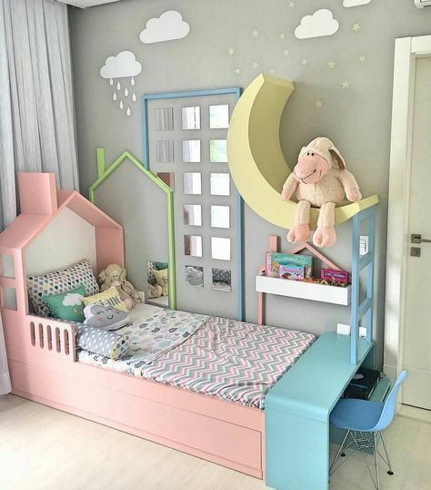 kids bedroom, beige floor, pink wooden bed platform, blue table, blue modern chair, moon decoration, shelves, grey wall, cloud picture