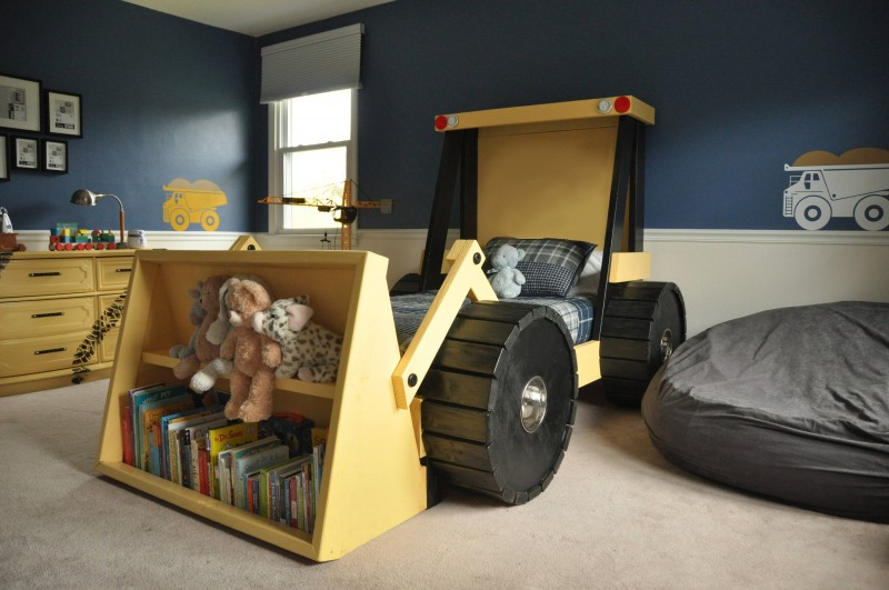 kids bedroom, brown floor, grey wall, beige wainscoting, tractor bed with shelves, brown wooden cabinet, bean bag