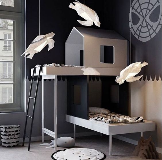 kids bedroom, grey wooden floor, grey wall, wooden bed platform shape like house, white paper pendants, laundry basket