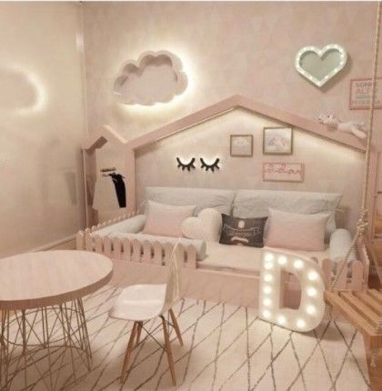 kids bedroom with pink wall, pink bed platform in house shaped, pink chair table, pink swing, wall decoration