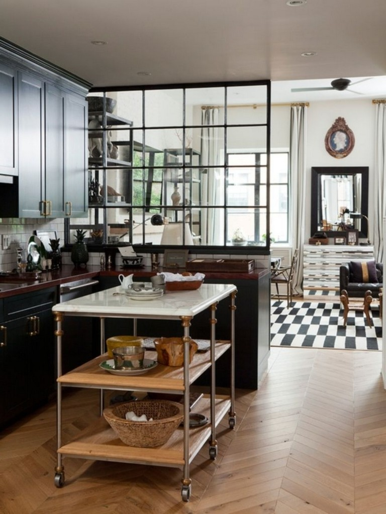 kitchen, black cabinet, dark red cabinet top, wooden chevron floor, sliding table, glass partition with black frame