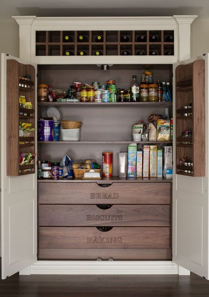 kitchen pantries, white cupboard, brown wooden shelves inside, brown wooden drawers with labels