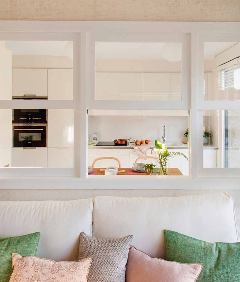 kitchen, white cabinet, wooden top island, white framed glass partition, white sofa, pillows