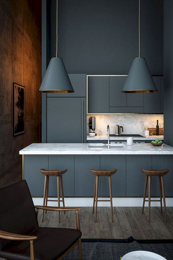 kitchen with modern island bar, grey island with white marble top, grey kitchen cabinet with golden lines, white marble backsplash golden lines, wooden stool