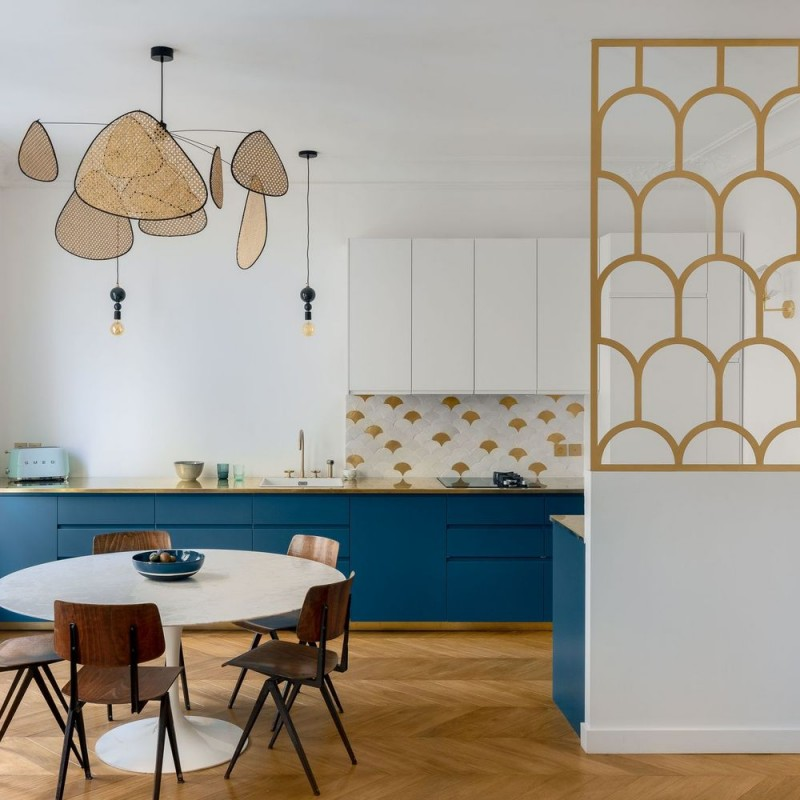 kitchen, wooden chevron floor, white wall, white upper cabinet, blue bottom cabinet, golden kitchen top, fish scales backsplash, golden fishscales partition