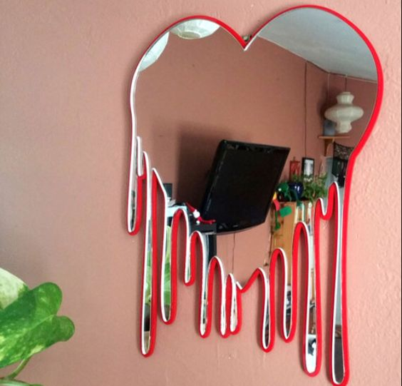 melting heart mirror with red frame