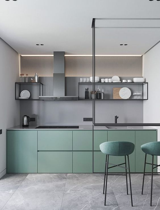 modern kitchen with green cabinet, grey wall, clear glass floating shelves with black frame, grey top, clear glass table bar with green stools