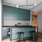 Modern Kitchen With Sage Green Cabinet, Black Kitchen Island Top, Black Round Stools, Modern Pendants