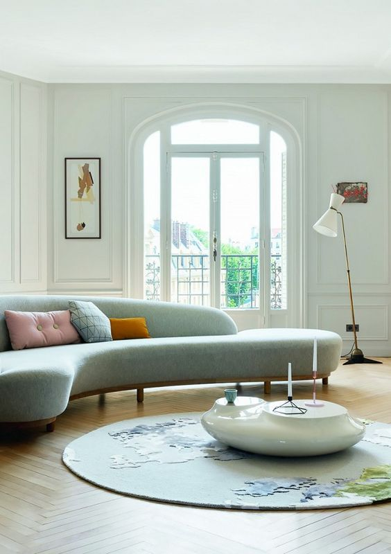 modern light blue curvy sofa with not fukk backm wooden support