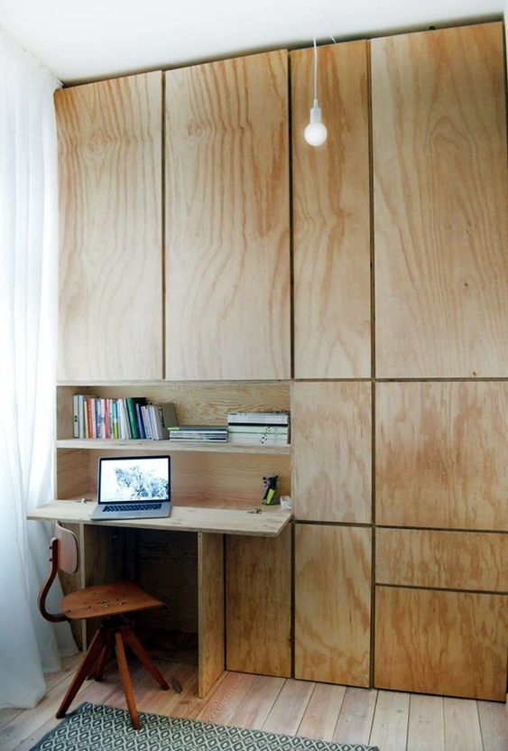 natural wood look on cupboard with folding table and shelves, wooden chair, wooden floor, green rug