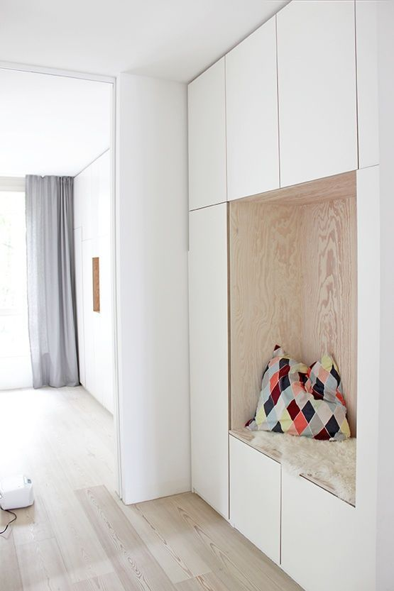 nook in the middle of white cupboard, plyboard side, pillow