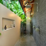 Outdoor Bathroom Ideas Grey Textured Wall Wall Mounted Rainfall Shower Puff Holder Mosaic Flooring Built In Shelf White Wall Wall Sconce
