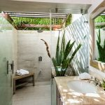 Outdoor Bathroom Ideas Shower Head Plant Wooden Corner Bench Wooden Vanity Beige Countertop Sink Faucet Wall Mirror Glass Shower Door