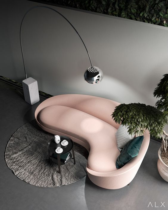 pale pink curvy sofa, pillows, grey floor, silver floor lamp, plants